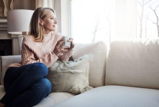 Woman Contemplating On Couch W Coffee In Handock 961897192 1024×689